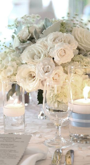 White centrepiece and candles.