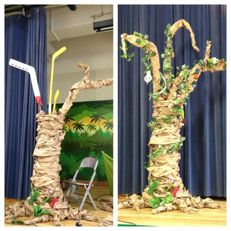 Using hockey sticks and a cement tube make DIY rainforest tree for school play.