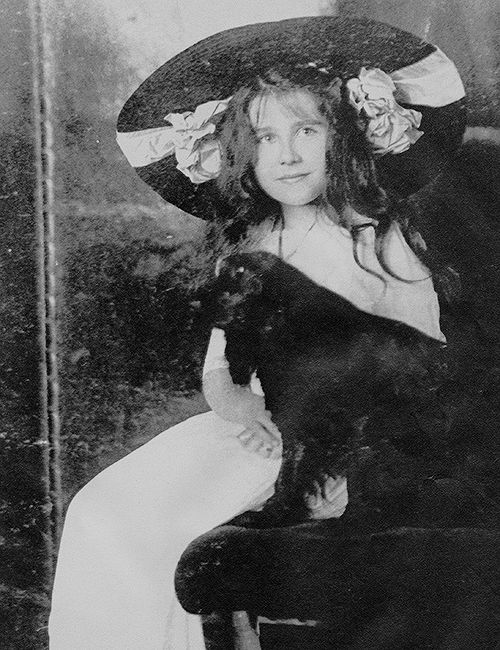 """margaretroses: """"Lady Elizabeth Bowes-Lyon photographed with her spaniel, Peter in 1907. """""""