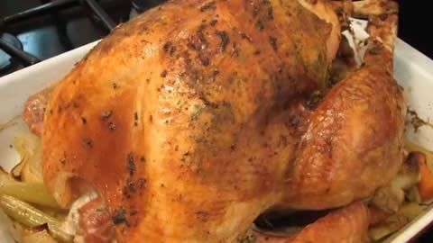 With an herbed butter rubbed under the skin and a maple syrup-orange glaze basted on the outside, this roast turkey is moist and delicious with a crispy skin.