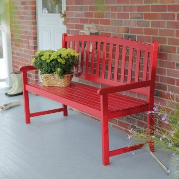A simple bench can serve as a focal point when adorned with a gorgeous basket of flowers.: Red Doors, Slats Curves, Wood Benches, Pleasant Bays, Coral Coast, Red Bench, Outdoor Wood, Outdoor Benches, Front Porches
