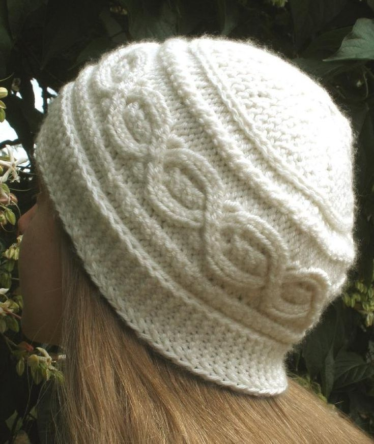 Knitting Pattern for Bavarian Twist Hat Knit Flat - This crisply textured cap is knit flat sideways, using short rows to shape the crown. It has a Bavarian twist stitch cable around the side of the cap, and a garter stitch border at the lower edge.