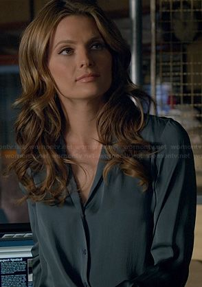 Beckett's blue silky blouse on Castle.  Outfit Details: http://wornontv.net/22428/ #Castle