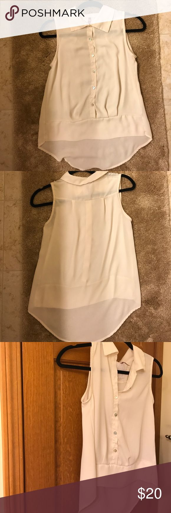 Semi-Sheer Cream Women's Sleeveless High-Low Top Perfect summer top to dress up or down. Listed size small. Semi-sheer top that would be perfect to wear with a camisole, bandeau, or bralette under. Dress it up or down with shorts, jeans, or a skirt. Delicate shell like buttons. Cream/off-white color. Rarely worn. Priced at $20, please let me know if you have questions or would like to inquire about more pictures! ❤️❤️ Mauve Tops Blouses