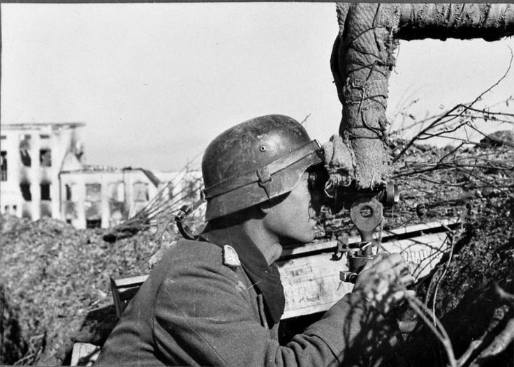 Stalingrad, Fall 1942. German observer searches for targets with his scissors field glasses. Note how the glasses are wrapped in camouflage for fear of snipers.