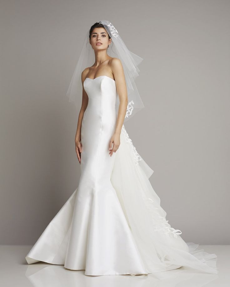 Slim strapless wedding dress of silk in mermaid style with eye-catching tulle flounces at the rear skirt of Giuseppe Papin