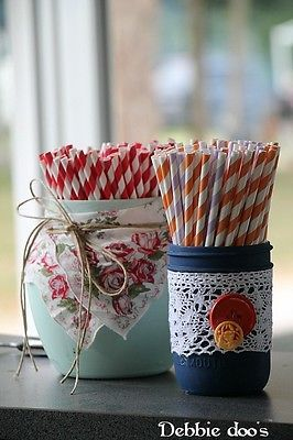 Painted mason jar embellished with vintage linens and buttons