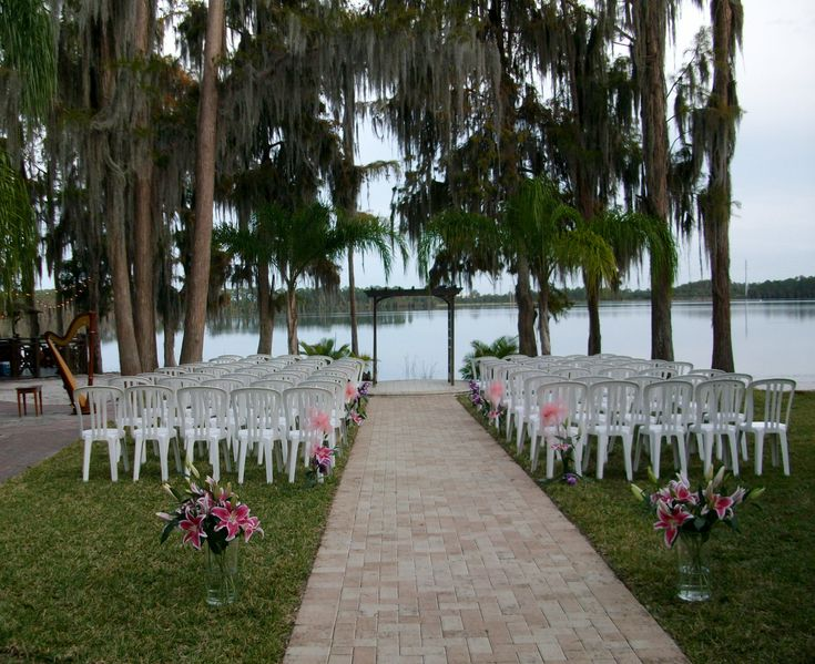 Wedding ceremony at Paradise Cove in south Orlando near Disney World. This is a gorgeous tropical wedding venue on the lake. #harpist #florida #destination #intimate #harp #music #musician #locations #venues