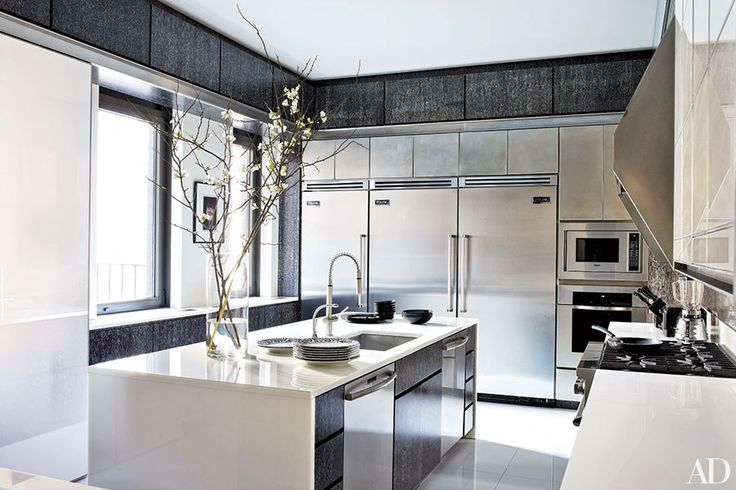 The kitchen in a floor-through Manhattan apartment is appointed with a range, microwave, and refrigerators all by Viking, and wall and cabinet panels of chocolate-brown cerused oak. Architect Mark Stumer and designer James Aman designed the Upper East Side home.