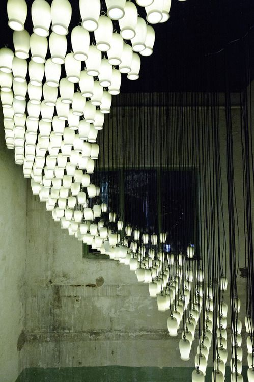 British artist Bruce Munro    1,664 reused yoghurt pots + bucket loads of creativity = stunning light installation.