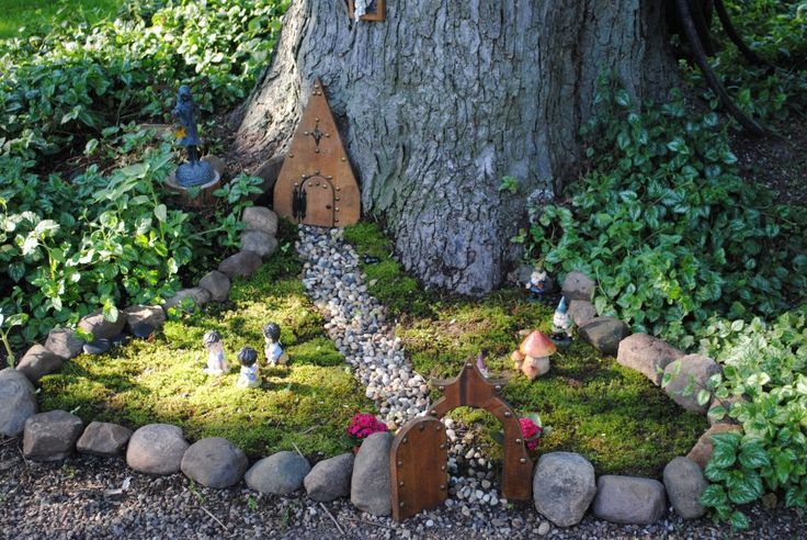 Fairy garden at tree base--stones for edging.