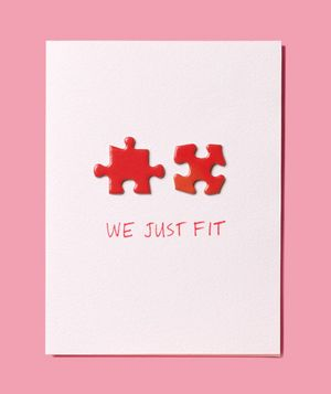 Turn spare puzzle pieces into a homemade Valentine's Day card with a marker and a bit of glue.