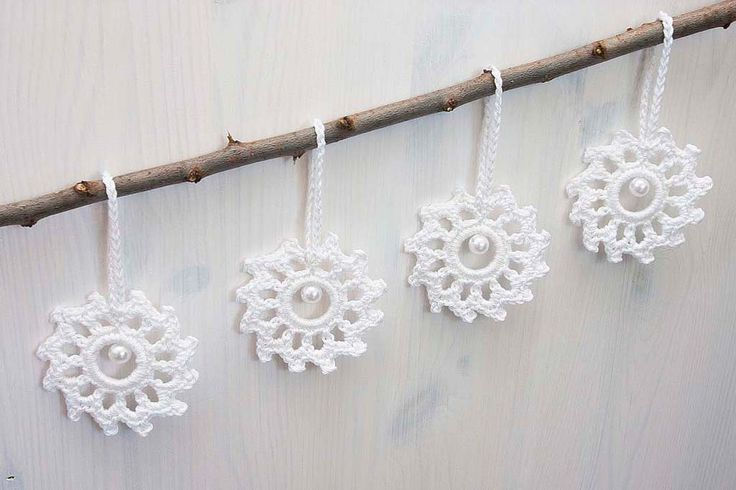 Beautiful white snowflakes, set of 4. Perfect accessories for Christmas tree, for home decor during Christmas time or as a small gift.  Crocheted from 100% cotton thread.