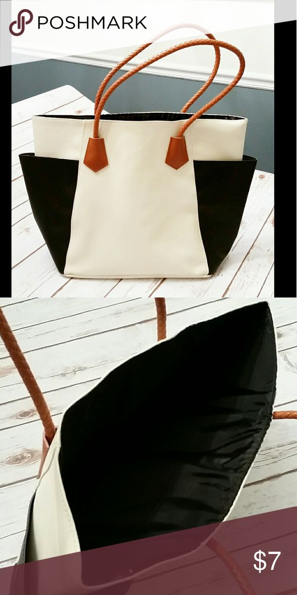Black and Cream Tote Bag Brand new without tags tote bag. If was a gift with purchase from Estee Lauder. 16 inches wide, 12 inches high and 4 inches deep. Bags