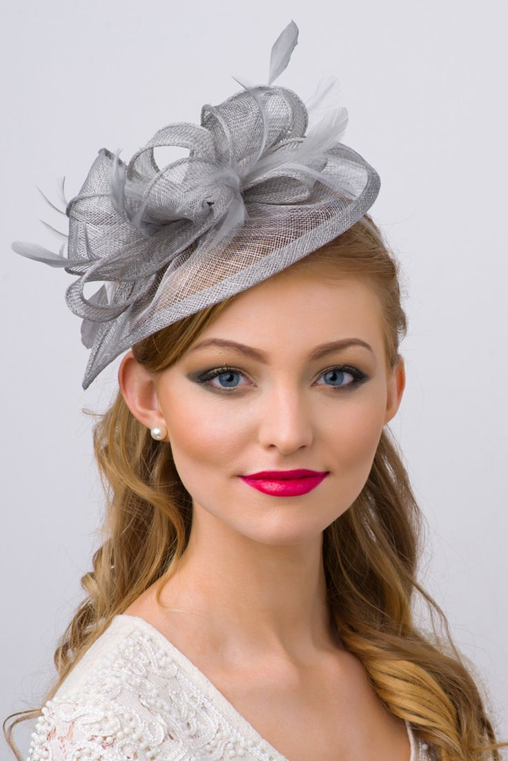 Timeless glamour. This sassy fascinator gives a nod to ...
