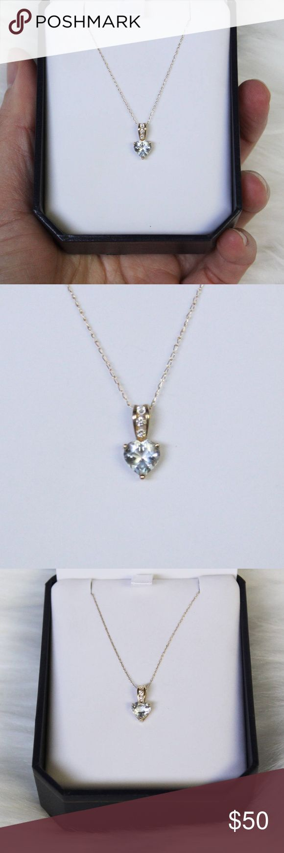 10k gold diamond aquamarine necklace 10k solid yellow gold chain and pendant Genuine Aquamarine heart shaped stone with three small round cut diamonds. Chain is 22 in long March birthstone Comes in box, ready to gift  Beautiful necklace in new condition! Jewelry Necklaces