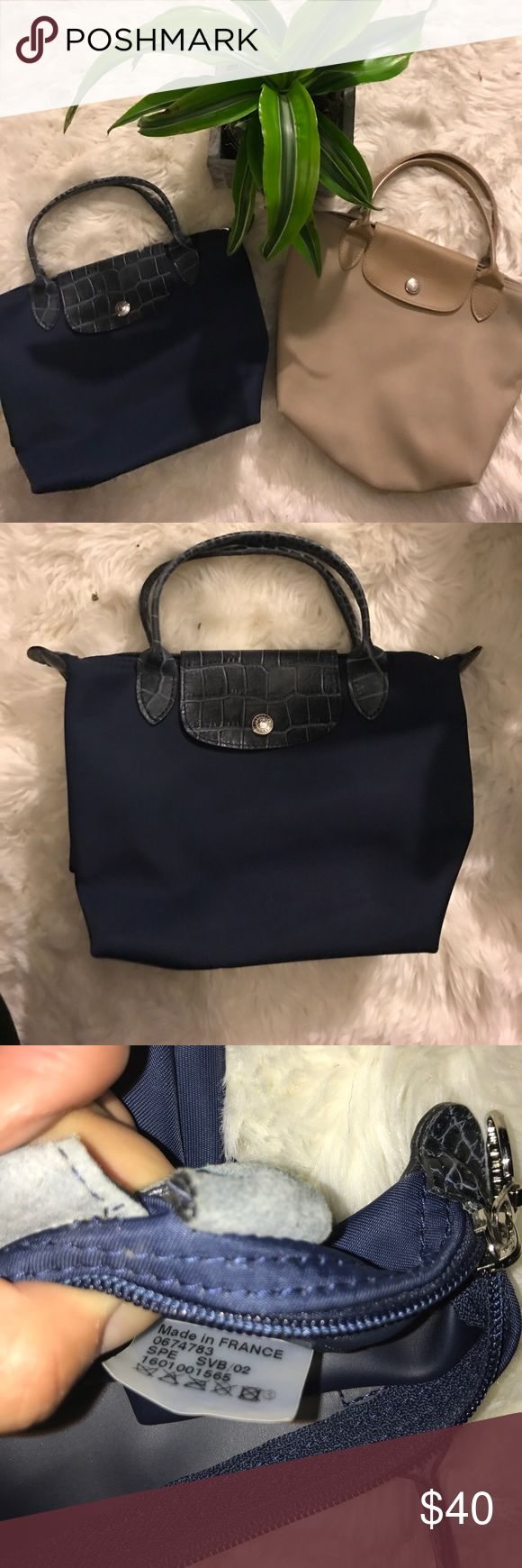 """Small Le Pliage Shoulder Tote: Longchamp Top zip closure with outer snap tab. Interior wall pocket. Water-resistant lining. Folds flat for storage. Nylon with leather trim. * same price for both   minor pen mark on print blue  - measurements : LENGTH 8""""  WIDTH 9.5""""  DEPTH  4.5"""" STRAP DROP 4.5"""" 🌸 Want to make me a reasonable offer? 👇🏽 Use the offer button, and we can negotiate a price.  💌 I'll send you a private exclusive offer  🔴 Means SALE! SALE! SALE 👑repeat shoppers! Shop with me…"""