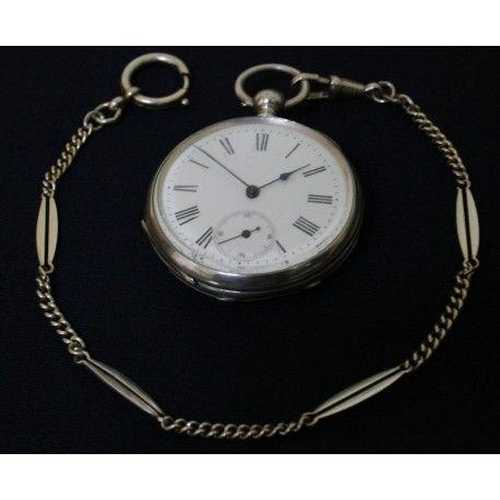 Elegante reloj de bolsillo, en plata maciza, cuerda con llave, y funcionando.