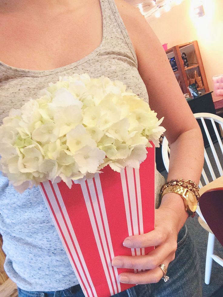 "Hydrangea and popcorn bag ""she's about to POP"" baby shower centerpiece"