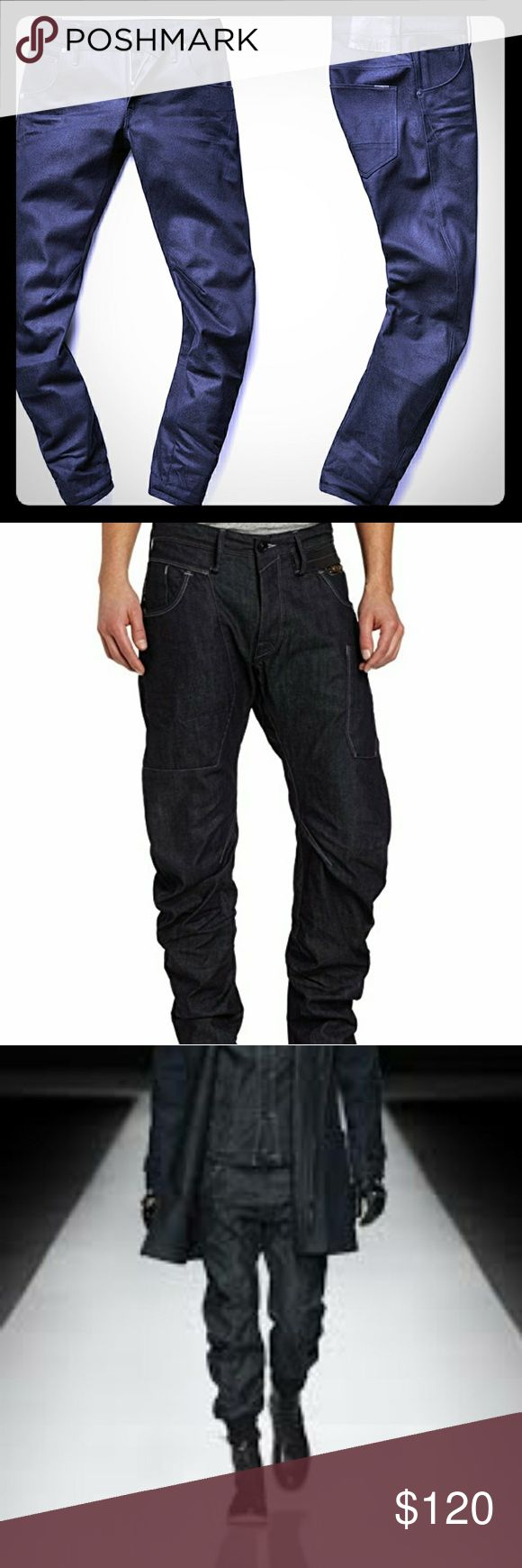 "G-Star RAW Men's""Modernist Army Radar Taper"" Jeans Constructed using G-Star RAW 3D design principles, the Army Radar jeans offers a bowed fit that turns around the legs. This means a tapered fit with enhanced comfort and movement. For a sporty silhouette, this seasonal version is complete with elasticated hems and adjustable waistline with button closures. Deep navy coloring with black stitching and details. These were THIS seasons HOTTEST NEW style of men's wear jeans and pants!! G-Star RAW…"