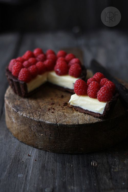 White chocolate mascarpone pie with raspberries and a chocolate crust.