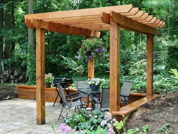 I like the look of this pergola the best I think... Nice widths of top, Iike the angle of the cut off &height/width. I think I prefer the no  corner bracing... at least the look of it  How to Build a Pergola
