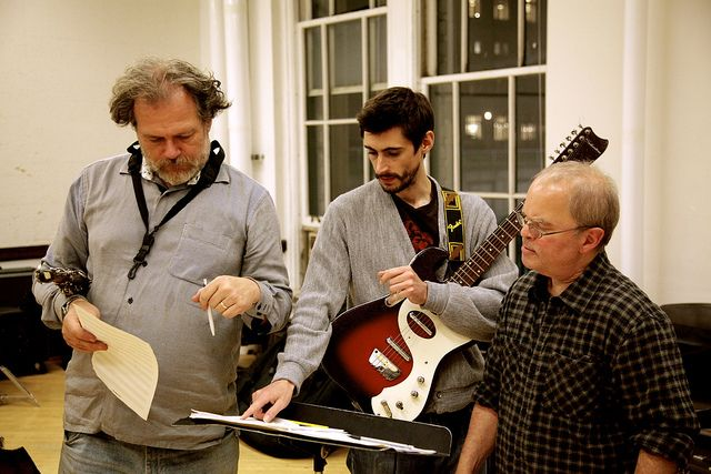3 members of Silk Sound; (right to left; Ben Opie, Chris Parker, and Jeff Berman) discuss a piece and how they are going to proceed with it.