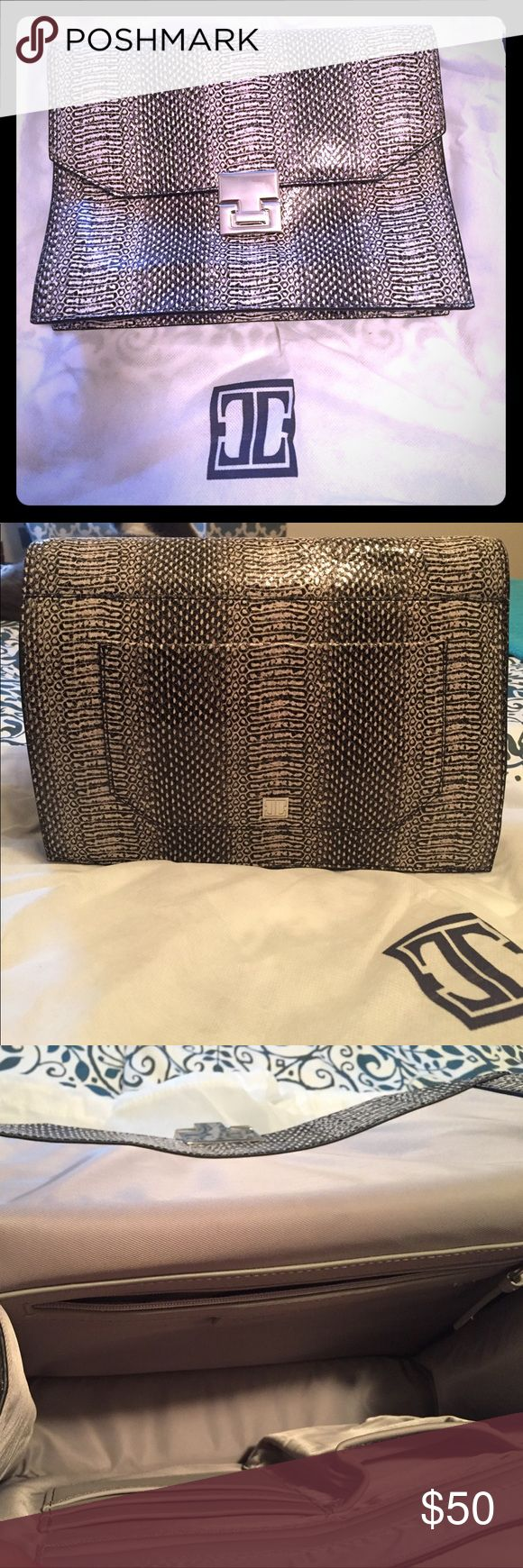 Snake skin Ivanka Trump clutch Classy black and white snake skin Ivanka Trump clutch. Only used once in like new condition with dust cover included. Ivanka Trump Bags Clutches & Wristlets