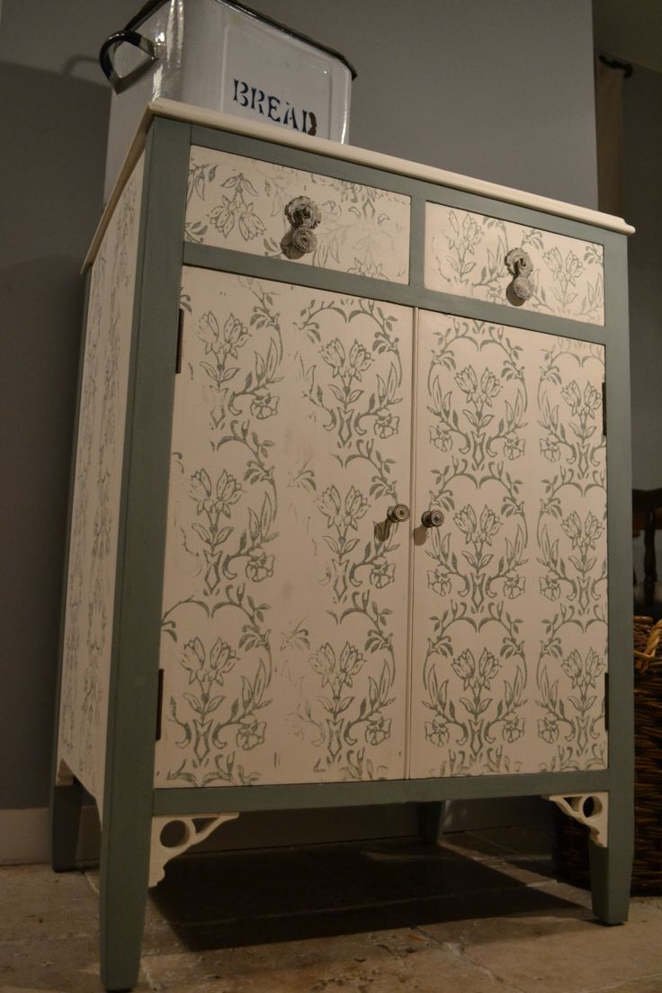 Vintage cabinet - reloved using 'huile de noix' white Autentico chalk paint, with beautiful flowered stencilling and the edges done in 'troubled water' Autentico chalk paint, finished with a coat of Autentico clear wax. The drawer and cupboard handles were also given a light coat of 'bright white' Autentico paint, completing the truly vintage look.