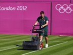 Painting the court lines at Wimbledon-tennis schedule for Olympics...