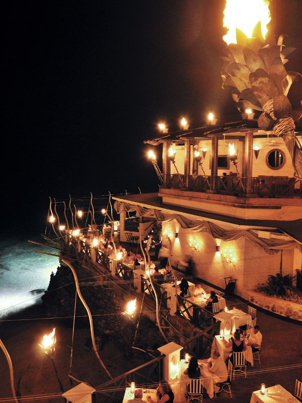 The Cliff restaurant in Barbados. I've been and this picture doesn't do it justice (none do from the website), but from personal experience I know it's a tough place to photograph. GO... - it's a dream, (so is Barbados).
