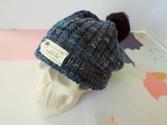 Punk style knitted beanie, handmade from moody blue pure New Zealand merino with upcycled black fur pom pom from Cornflake Purl on Etsy