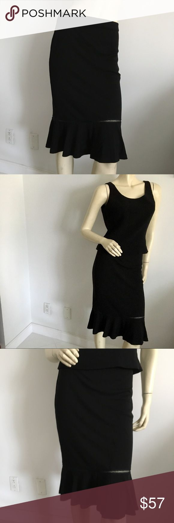 NWOT Vtg max studio stretch trumpet skirt NWOT vintage Max studio black stretchy trumpet skirt with lace ribbon above hem. Fit above or over the knee depending on your height (mannequin is 6') Size Small. Made In USA. Max Studio Skirts