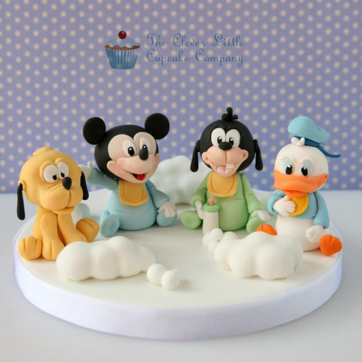17 best images about baby minnie mouse and mickey mouse on for Baby footprints cake decoration