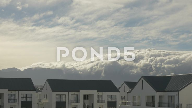 4K Clouds Moving Across Mountain Tops & Apartment Blocks Time Lapse - Stock Footage | by RyanJonesFilms