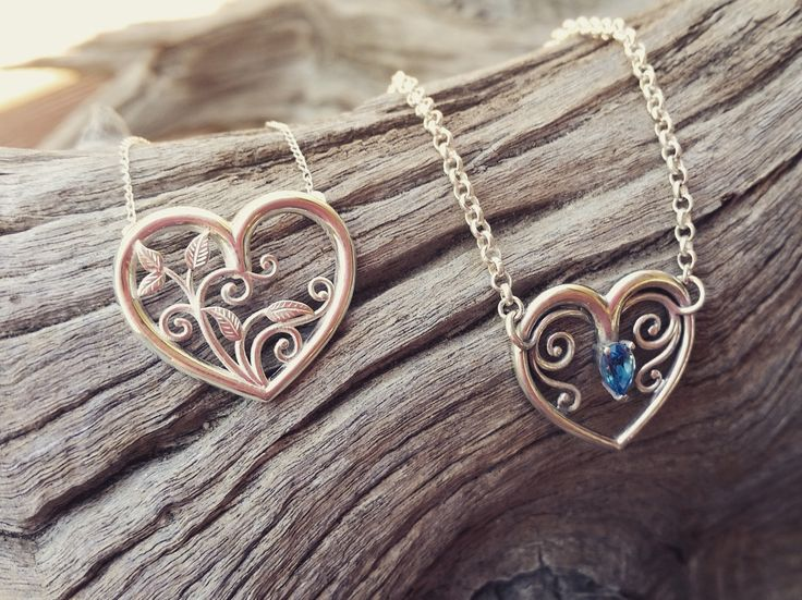 Adorned By Sally Sterling silver heart pendant set with a 6x4mm blue Topaz $170