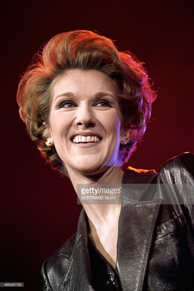 Canadian singer Celine Dion performs December 4, 1995 on the stage of Bercy concert hall in Paris.