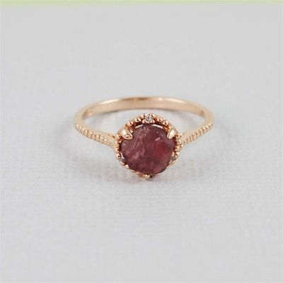 Rose gold raw garnet ring // I love the look of the raw stone, and the setting is simple enough that the stone stays the main feature. $50.