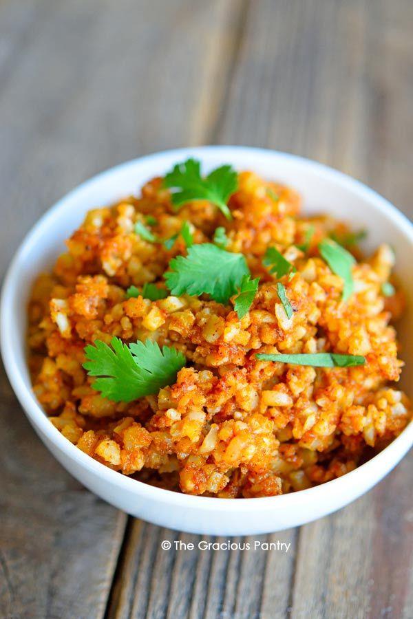 Clean Eating Spanish Cauli-Rice - oil, riced cauliflower, tomato paste, garlic powder, onion powder, ground cumin, chili powder, salt