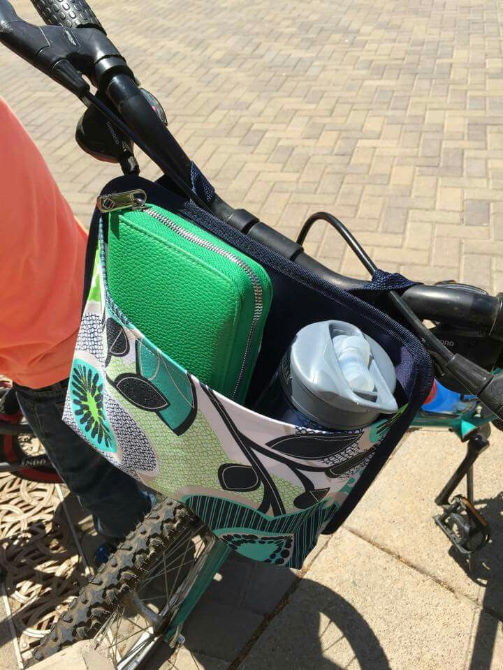 Love the Thirty-One Oh Snap pocket for holding my wallet and water bottle while on a bike ride!