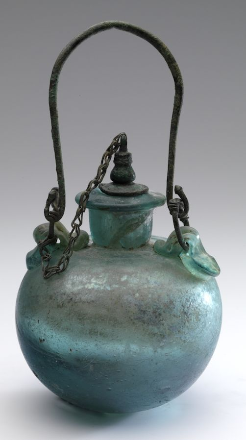 ROMAN GLASS ARYBALLOS WITH CHAIN & STOPPER. Second half of 1st century AD Eastern Mediterranean, probably Asia Minor. Size 7.3 cm (body) 7.0 cm. Weight 188 g. Hans van Rossum - Allaire Collection.