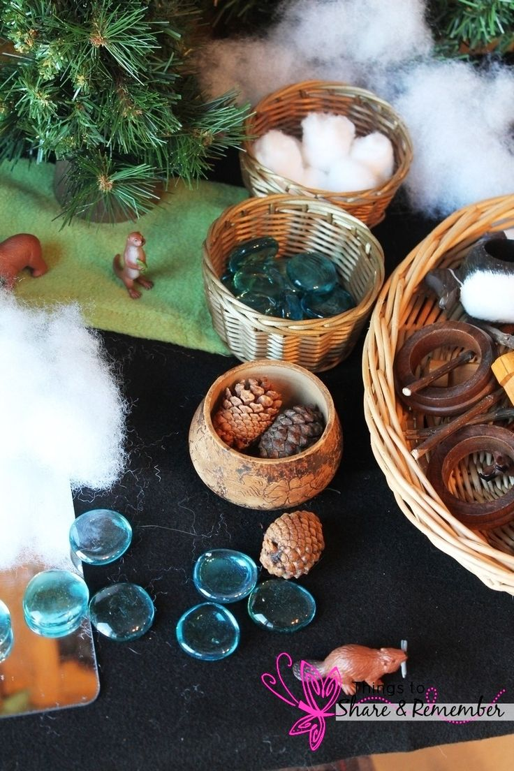 Seasonal science area with small world play Winter in the Woods Invitation to Play & Small World Play