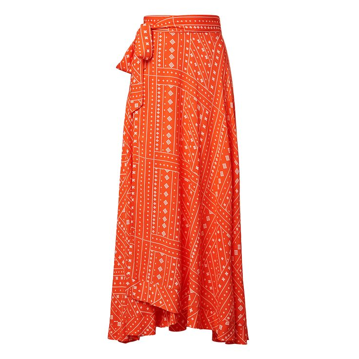 100% Viscose Printed Wrap Skirt. Comfortable fitting silhouette features a semi fixed high waistband with tie, wrap front body with frill maxi hem in an all over handkerchief print. Available in Multi as shown.
