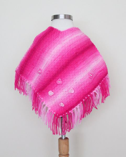 http://www.woollyandwarmy.com/collections/baby-pancho/products/baby-pancho-554-05