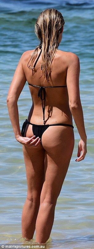 Cheeky girl! Laura Dundovic wore a very small black bikiniduring a swimming session at Sydney's Balmoral Beach on Friday