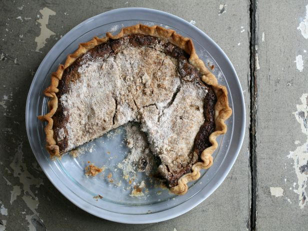 This simple brown sugar-and-molasses Shoofly Pie is a Pennsylvania Dutch classic, best served with a a pile of whipped cream or a scoop of vanilla ice cream.