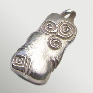 A true representation of the Newgrange Entrance Stone. Hand carved in wax, this Handcrafted pendant showcases the enigmatic beauty of the tri-spiral.  The iconic tri-spiral design carved on the entrance stone of Newgrange is an eternity symbol, in constant flow, with no beginning and no ending. The three joined spirals may represent three Celtic worlds – spiritual, present and celestial, or they may represent the cycle of birth, life and death, or past, present and future.