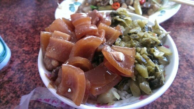 Pigs ear, mustard greens and rice. Yummy.