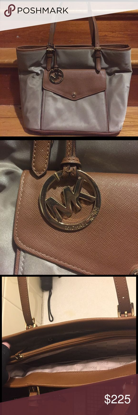 MICHAEL KORS purse Beige and brown purse- used only a few times, no flaws! Has two large pockets on the inside, one large zipper pocket and one small button pocket on the outside. Michael Kors Bags Shoulder Bags