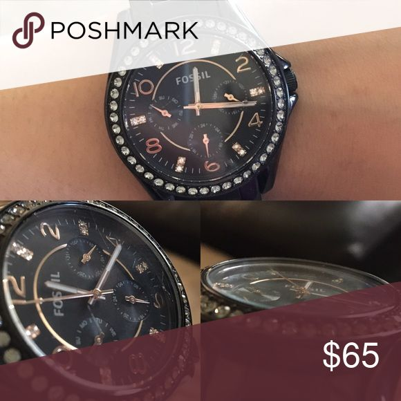 Fossil watch Beautiful black and rose gold watch. Battery still works. Great condition! Minor scratches on the surface but hardly noticeable. Fossil Accessories Watches